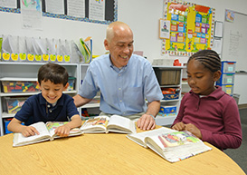 Mt. Helix Academy's Director, Mr. Collins, enjoying the reading proficiency of young students
